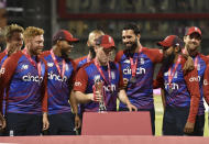 England captain Eoin Morgan, fourth right, holds the winners trophy after the third Twenty20 international cricket match between England and Pakistan at Old Trafford in Manchester, Tuesday, July 20, 2021. England won the series 2-1. (AP Photo/Rui Vieira)