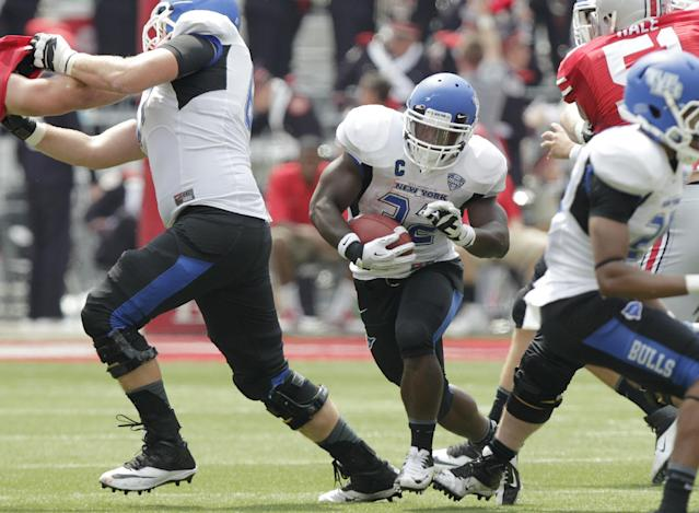 Buffalo running back Branden Oliver breaks through the line against Ohio State during the second quarter of an NCAA college football game Saturday, Aug. 31, 2013, in Columbus, Ohio. (AP Photo/Jay LaPrete)