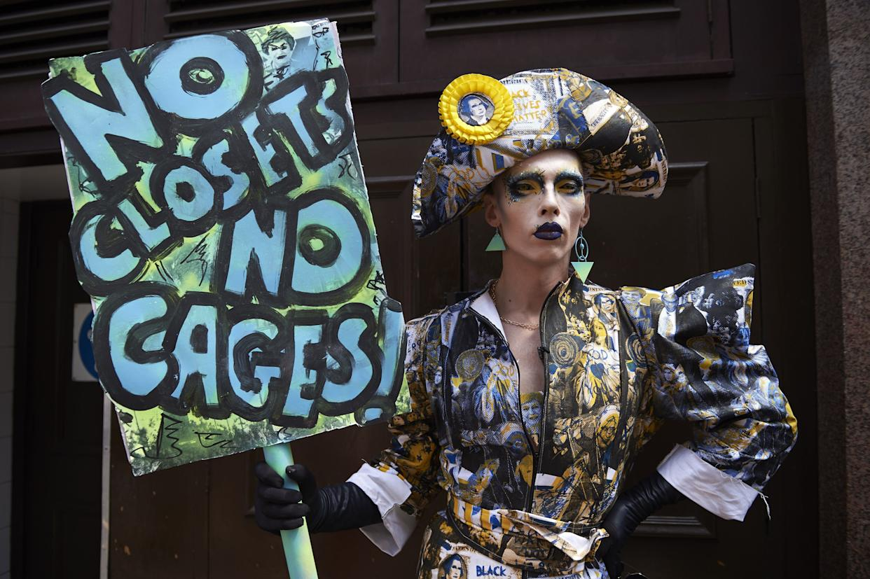 A drag queen joins protesters against the UK visit of US President Donald Trump as they gather to take part in a march and rally in London.