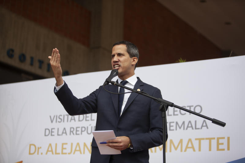 National Assembly President and self-proclaimed interim president of Venezuela Juan Guaido speaks during a press conference after Guatemala's president elect Alejandro Giammattei was denied entry into Venezuela, at the Metropolitan University in Caracas, Venezuela, Saturday, October 12, 2019. Giammattei said he landed early Saturday at the airport near Caracas, but officials denied his entry, escorting him to a departing plane. (AP Photo/Andrea Hernandez Briceño)