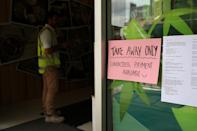 New South Wales begins shutting down non-essential businesses and moving toward harsh penalties to enforce self-isolation as the spread of coronavirus disease (COVID-19) reached a 'critical stage' in Sydney