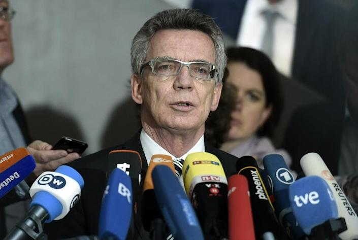 German Interior Minister Thomas de Maiziere -- who oversaw the spy services from 2005-09 -- speaks to journalists after he arrives to attend a meeting in Berlin, on May 6, 2015 (AFP Photo/Odd Andersen)