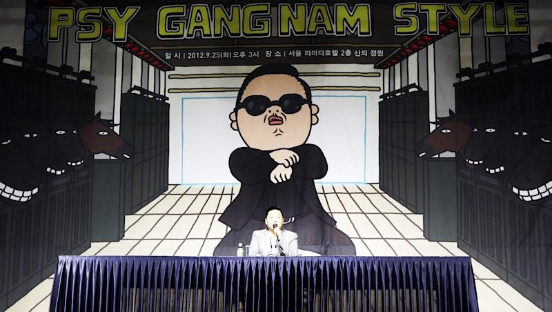"""FILE - In this Sept. 25, 2012, file photo, South Korean rapper PSY, who sings the popular """"Gangnam Style"""" song, answers reporters' question during a press conference in Seoul, South Korea. In Google's 12th annual roundup of trending searches, PSY's """"Gangnam Style"""" music video trotted into second spot in 2012, a testament to his self-deprecating giddy-up dance move. (AP Photo/Lee Jin-man, File)"""