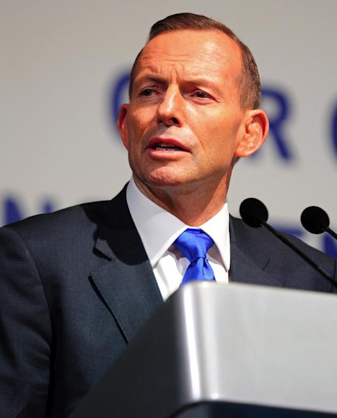 Australia's Prime Minister Tony Abbott (pictured in June 2015) is a conservative who once trained to be a Catholic priest (AFP Photo/Mohd Fyrol)