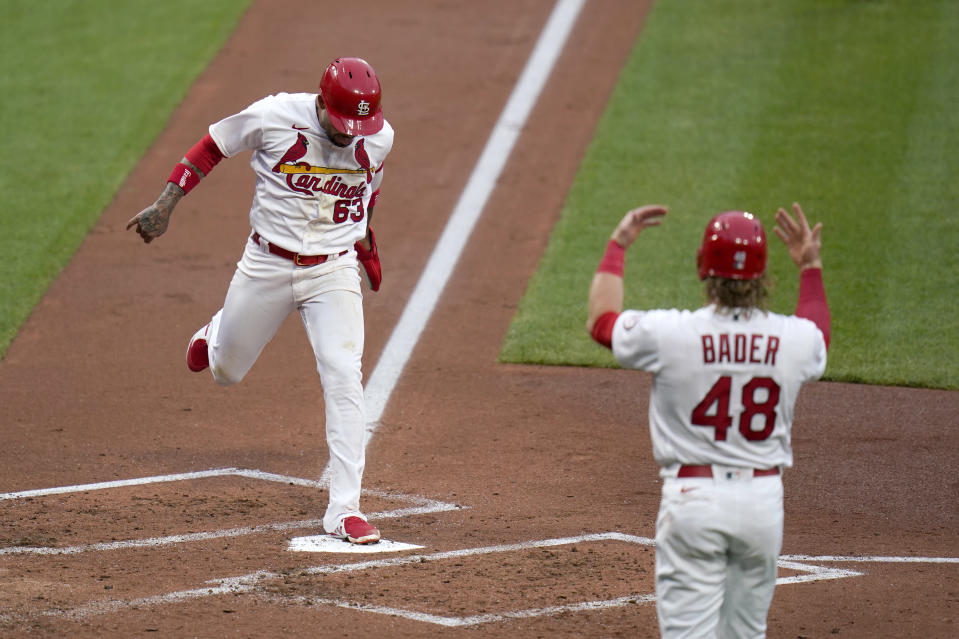 St. Louis Cardinals' Harrison Bader (48) celebrates as teammate Edmundo Sosa (63) scores during the second inning of a baseball game against the Pittsburgh Pirates Tuesday, May 18, 2021, in St. Louis. (AP Photo/Jeff Roberson)