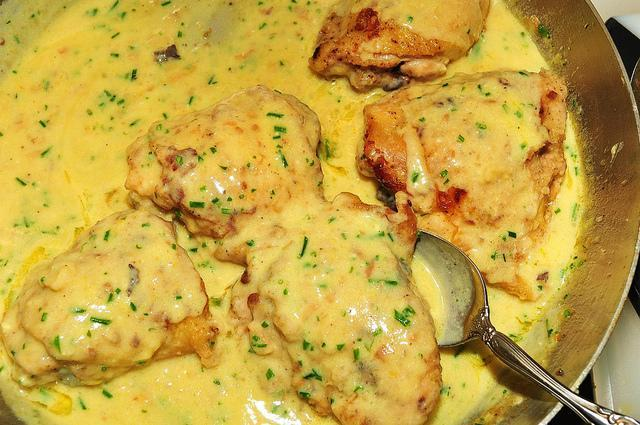 """<p>To make delicious nimbu chicken, marinate 500 gms boneless chicken with salt, turmeric, 1 tsp ginger garlic paste & juice of 2 lemons for couple of hours. In a kadhai, heat some oil & add 3-4 slit green chilies & fry. Add the marinated chicken & cook for 5-10 minutes. Add dry masala powders- coriander, garam masala & red chili powder to taste. Now add 150 gms fresh cream & cook the chicken till done. Add juice of one more lemon & garnish with finely chopped corainder & serve. """"Creative Commons lemon chicken"""" by jeffreyw is licensed under CC BY 2.0 </p>"""