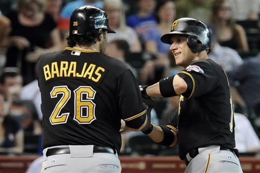 Pittsburgh Pirates' Clint Barmes, right, is congratulated by Rod Barajas after hitting a two-run home run against the Houston Astros in the second inning of a baseball game, Thursday, July 26, 2012, in Houston. (AP Photo/Pat Sullivan)