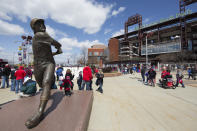 FILE - In this Thursday, April 5, 2018 file photo, a statue of Philadelphia Phillies' Mike Schmidt looks on as fans mingle outside of Citizens Bank Park prior to a baseball game against the Miami Marlins in Philadelphia. (AP Photo/Chris Szagola, File)