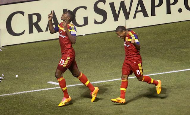 Real Salt Lake's Olmes Garcia (13) celebrates with Joao Plata (8) after scoring against the Montreal Impact during an MLS soccer game Thursday, July 24, 2014, in Sandy, Utah. (AP Photo/Rick Bowmer)
