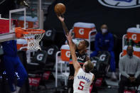 San Antonio Spurs guard Lonnie Walker IV shoots next to Los Angeles Clippers guard Luke Kennard (5) during the first quarter of an NBA basketball game Tuesday, Jan. 5, 2021, in Los Angeles. (AP Photo/Ashley Landis)