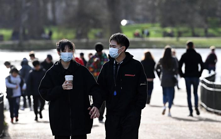 <p>People will be allowed to meet outdoors with one person from outside their household from 8 March</p> (EPA)