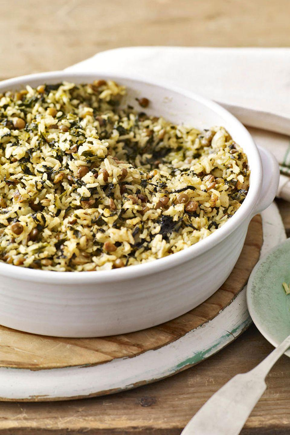 "Baked with lentils and rice in this casserole recipe, frozen spinach makes for a healthy and filling dinner. <a href=""https://www.countryliving.com/food-drinks/recipes/a2798/curried-spinach-lentil-bake-recipe/"" rel=""nofollow noopener"" target=""_blank"" data-ylk=""slk:Get the recipe."" class=""link rapid-noclick-resp""><strong>Get the recipe.</strong></a>"