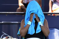 Naomi Osaka, of Japan, covers her head with a towel during her quarterfinal match against Maria Sakkari, of Greece, at the Miami Open tennis tournament, Wednesday, March 31, 2021, in Miami Gardens, Fla. Sakkari won 6-0, 6-4. (AP Photo/Lynne Sladky)