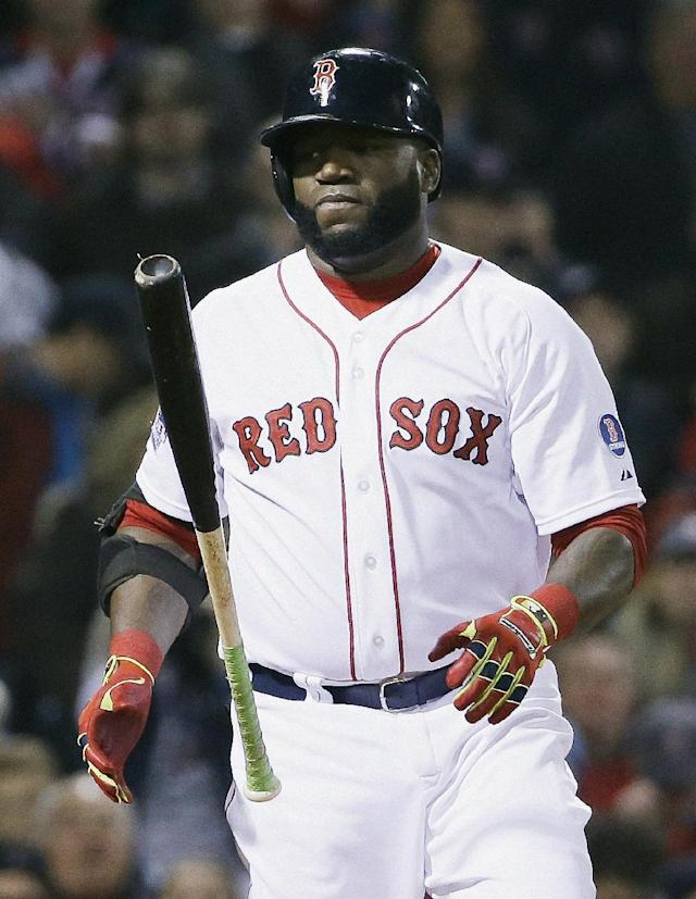 Boston Red Sox's David Ortiz tosses his bat after striking out during the sixth inning of Game 6 of baseball's World Series against the St. Louis Cardinals Wednesday, Oct. 30, 2013, in Boston. (AP Photo/David J. Phillip)