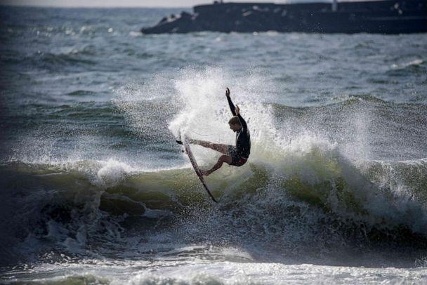 PHOTO: John John Florence of the United States rides a wave during a free session at the Tsurigasaki Surfing Beach, in Chiba, on July 26, 2021 during the Tokyo 2020 Olympic Games. (Olivier Morin/AFP via Getty Images)