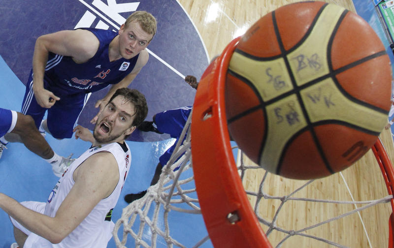 Pau Gasol  in  front, of Spain watches a ball go in during the EuroBasket 2011, European Basketball Championships group A match between Spain and Britain  in Panevezys, Lithuania, on Friday, Sept. 2, 2011. (AP Photo/Mindaugas Kulbis)
