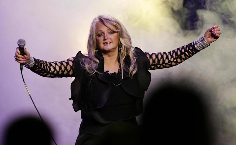 "FILE - In this file photo dated Nov. 1, 2009, British singer Bonnie Tyler performs in London. Britain has chosen Welsh singer Bonnie Tyler as its entry to the continent-wide Eurovision Song Contest. Tyler said Thursday March 7, 2013 that she is ""honored and delighted"" to represent her country with the song ""Believe in Me."" (AP Photo/PA, Yui Mok, File) UNITED KINGDOM OUT  NO SALES  NO ARCHIVE"
