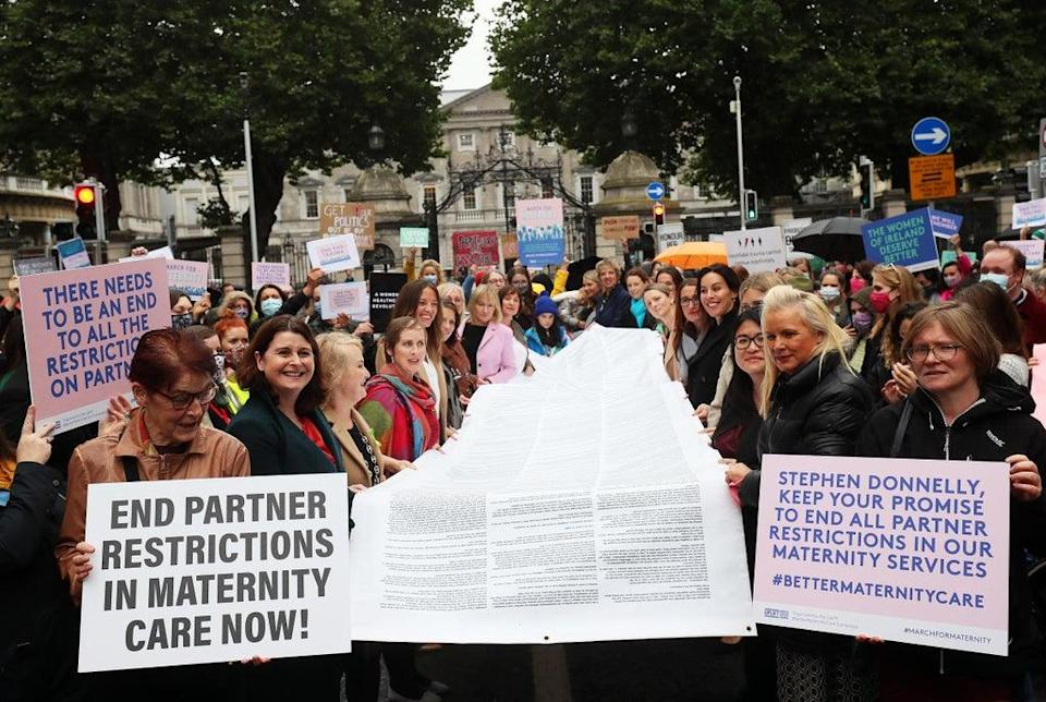 A scroll containing hundreds of stories of people's experience of being pregnant and giving birth during Covid was on show during the protest (Brian Lawless/PA) (PA Wire)