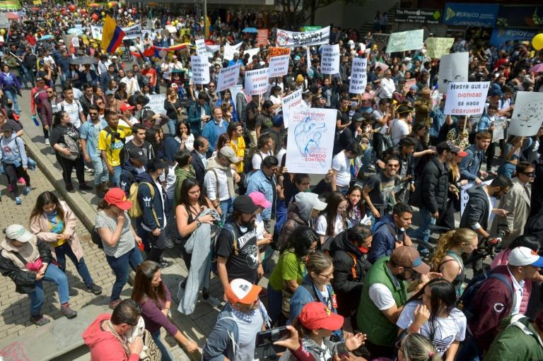 People march in Bogota during a nationwide strike