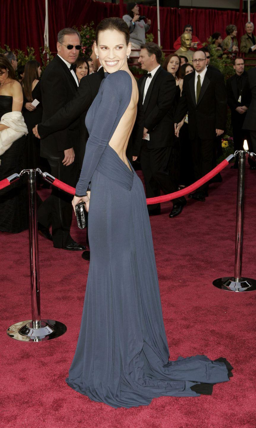 <p>Who could ever forget this daring Guy Laroche dress? The actress nailed her over-the-shoulder poses on the red carpet that night to emphasize the backless number. She also picked up the Best Actress Oscar for her role in <em>Million Dollar Baby</em>. </p>