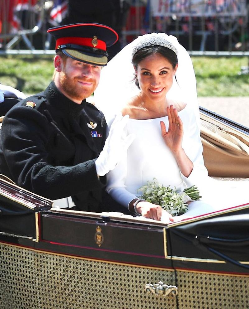 Prince Harry and Meghan Markle on their carriage procession following their nuptials in St. George's Chapel