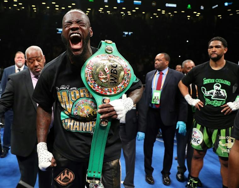 Deontay Wilder celebrates after his first round knockout of Dominic Breazeale in his WBC heavyweight world title defence