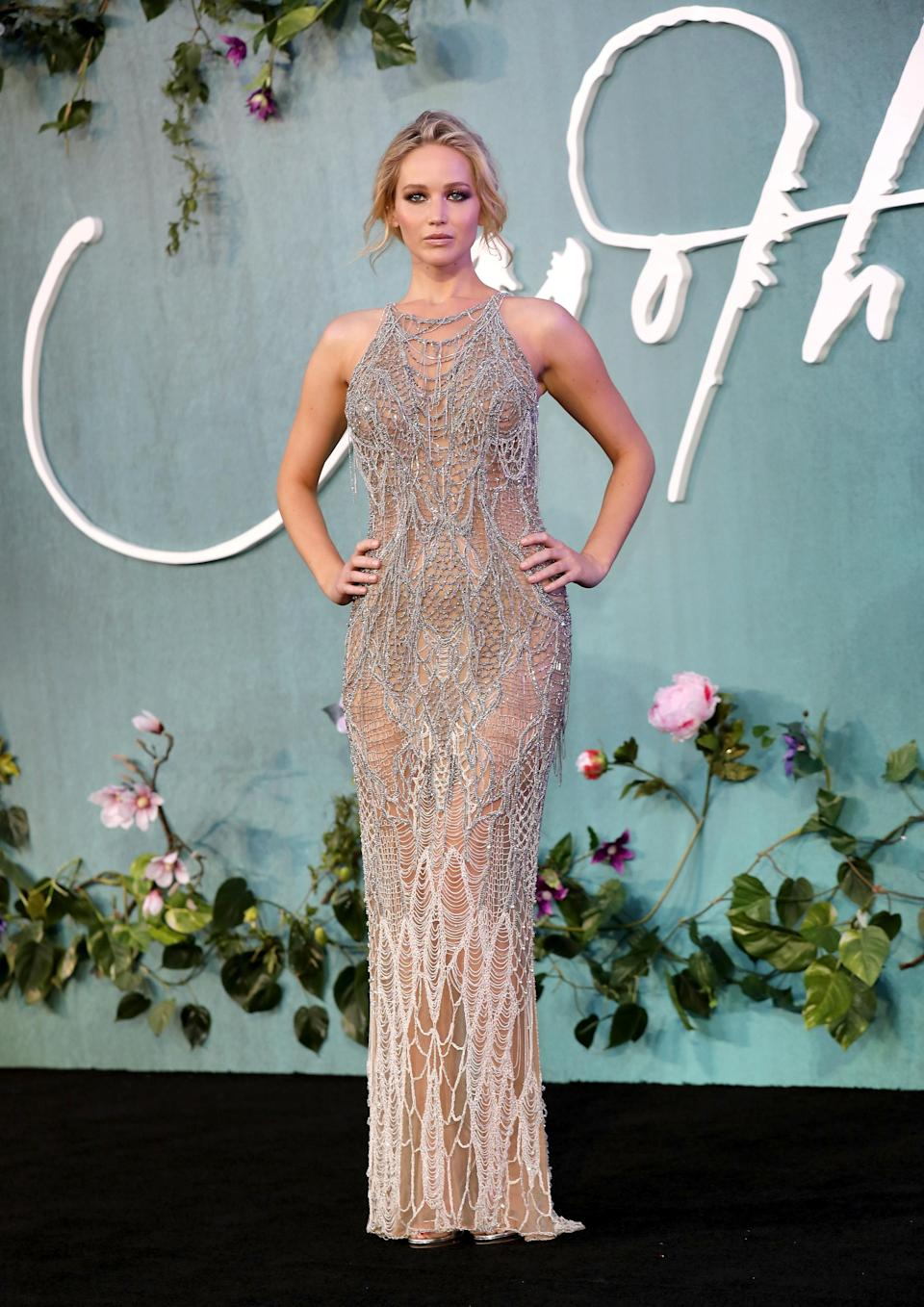 <p>J Law went down the high fashion route, opting for a cobwebbed silver Versace gown. <br><i>[Photo: Getty]</i> </p>