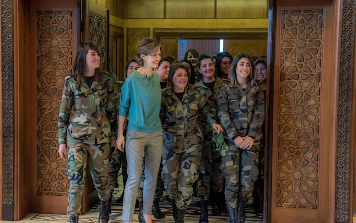Bashar al-Assad's British-born wife Asma with female troops on the occasion of Mother's Day in 2018S - Sana