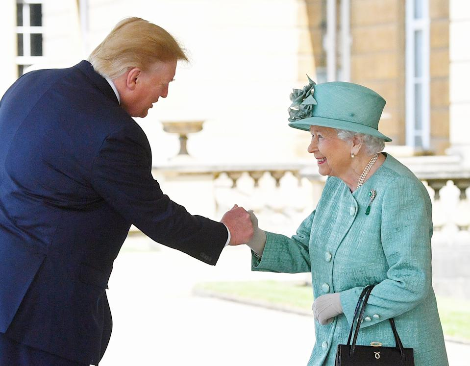 Queen Elizabeth II greets US President Donald Trump as he arrives for the Ceremonial Welcome at Buckingham Palace, London, on day one of his three day state visit to the UK. Spectators on social media claimed the President had fist bumped the Qu (PA)