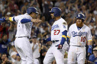 Los Angeles Dodgers' Matt Kemp, center, is greeted at home plate by Manny Machado, left, and Justin Turner after hitting a three-run homer in the eighth inning of a baseball game against the Arizona Diamondbacks, Saturday, Sept. 1, 2018, in Los Angeles. (AP Photo/Michael Owen Baker)