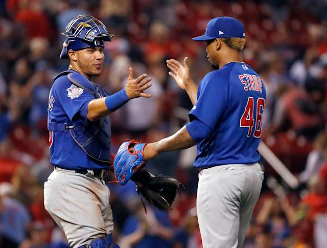 Here's hoping for plenty of handshakes between Willson Contreras and Pedro Strop. (AP Photo/Jeff Roberson)