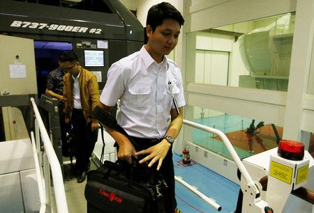 Fadil Arafat, an aviation student of Lion Air Group, leaves Boeing 737-900ER simulator after a Jet Introduction session at Angkasa Training Center near Jakarta, Indonesia, November 2, 2018. REUTERS/Willy Kurniawan