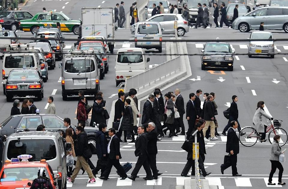 Official Japanese data shows the economy grew 0.6% in the first three months of the year, after limping out of recession in the previous quarter (AFP Photo/Kazuhiro Nogi)
