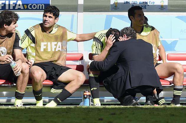 Spain's forward David Villa is comforted by Diego Costa after he was substituted during the match between Australia and Spain at the Baixada Arena in Curitiba during the World Cup on June 23, 2014 (AFP Photo/Juan Barreto)