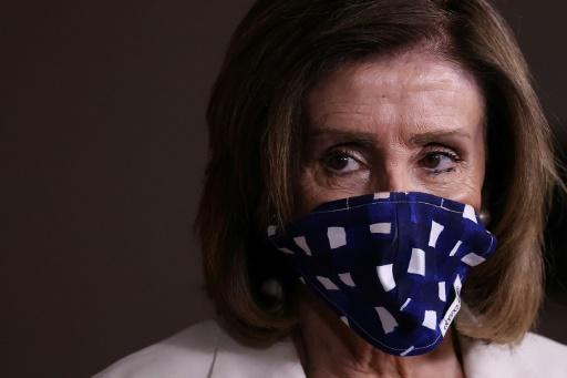 US House speaker Nancy Pelosi, seen wearing a protective mask at a May 7, 2020 briefing, has urged President Donald Trump to set an example by doing the same
