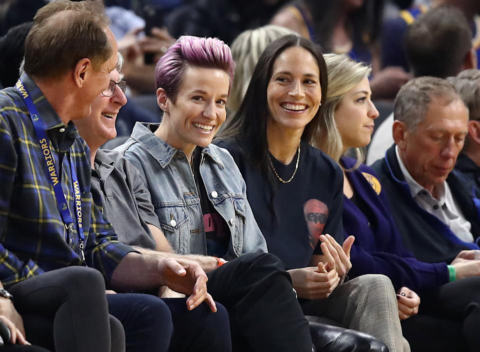 SAN FRANCISCO, CALIFORNIA - OCTOBER 30:  Soccer star Megan Rapinoe and WNBA star Sue Bird watch the Golden State Warriors play against the Phoenix Suns at Chase Center on October 30, 2019 in San Francisco, California.  NOTE TO USER: User expressly acknowledges and agrees that, by downloading and or using this photograph, User is consenting to the terms and conditions of the Getty Images License Agreement. (Photo by Ezra Shaw/Getty Images)
