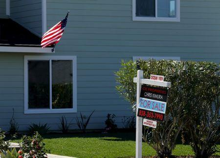 "FILE PHOTO: A ""For Sale"" sign is seen outside a home in Cardiff, California"
