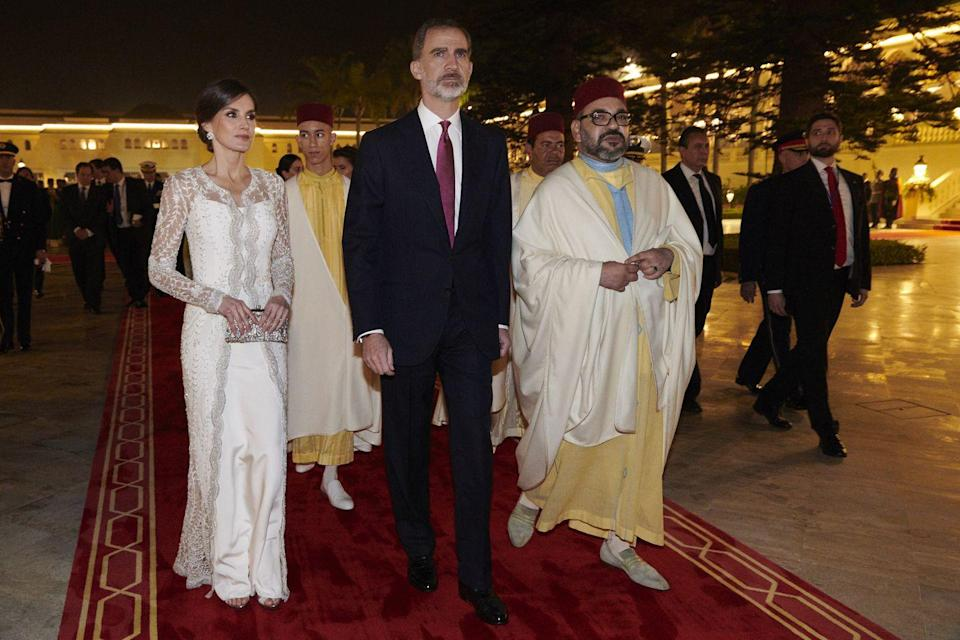 <p>During a visit to Morocco, Letizia wore a white gown with an embroidered, long-sleeved overlay. </p>