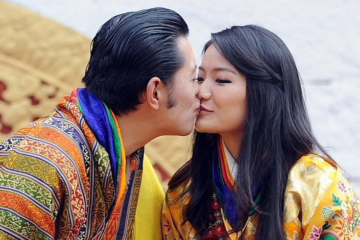 His majesty King Jigme Khesar Namgyel Wangchuck, 31, and Queen Jetsun Pema, 21, walk out after their marriage ceremony is completed on October 13, 2011 in Punakha, Bhutan.