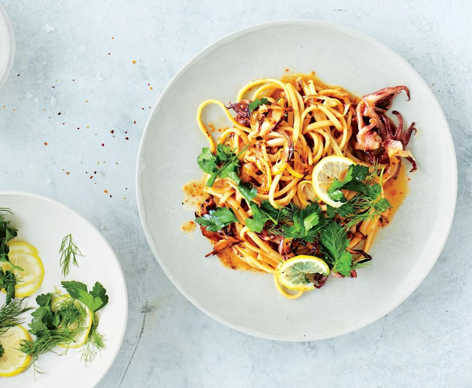"""On a warm, sunny day, pasta calls for fresh seafood, a big handful of herbs, and punchy lemon. All that's missing is the beach house. <a href=""""https://www.bonappetit.com/recipe/squid-and-fennel-pasta-with-lemon-and-herbs?mbid=synd_yahoo_rss"""" rel=""""nofollow noopener"""" target=""""_blank"""" data-ylk=""""slk:See recipe."""" class=""""link rapid-noclick-resp"""">See recipe.</a>"""