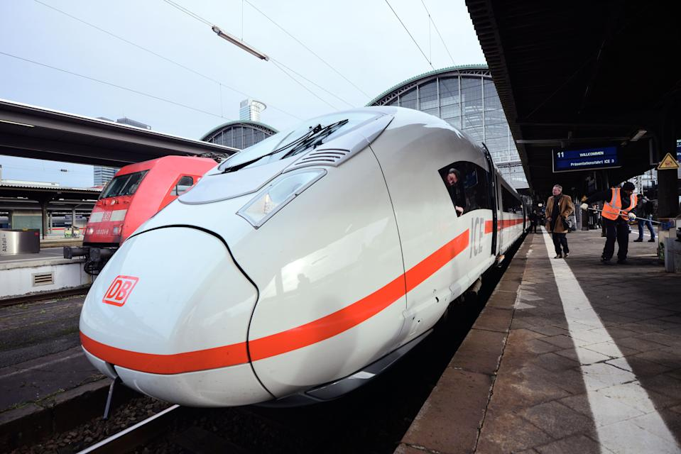 FRANKFURT AM MAIN, GERMANY - FEBRUARY 18:  The latest generation of the ICE 3 Deutsche Bahn high-speed train, version 407, stands during a media presentation at the main station on February 18, 2014 at Frankfurt/Main, Germany. The operation of version 407 was delayed by two years due to complications with certification. The train, built by Siemens, has a top speed of 320km per hour for the admission in France. In Germany the top speed is around 300km per hour.  (Photo by Thomas Lohnes/Getty Images)