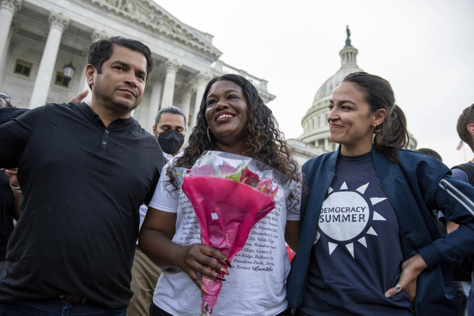 From left, Rep. Jimmy Gomez, D-Calif., Rep. Cori Bush, D-Mo., and Rep. Alexandria Ocasio-Cortez, D-N.Y., embrace each other after it was announced that the Biden administration will enact a targeted nationwide eviction moratorium outside of Capitol Hill in Washington on Tuesday, August 3, 2021. For the past five days, lawmakers and activists primarily led by Rep. Cori Bush, D-Mo., have been sitting in on the steps of Capitol Hill to protest the expiration of the eviction moratorium. (AP Photo/Amanda Andrade-Rhoades)