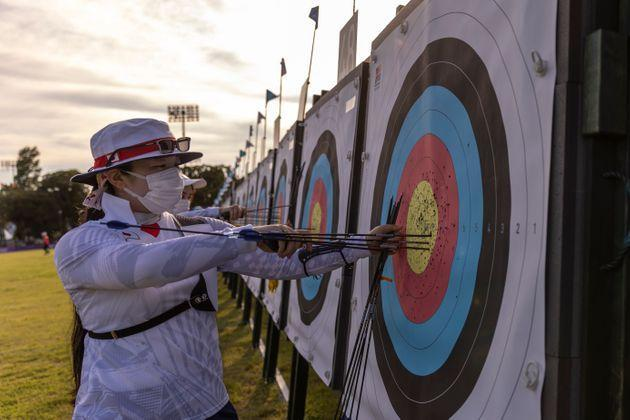 TOKYO, JAPAN - JULY 20: Athletes of Team Japan retreive arrows from the board during Archery practice at Yumenoshima Park Archery Field ahead of the Tokyo 2020 Olympic Games on July 20, 2021 in Tokyo, Japan. (Photo by Maja Hitij/Getty Images) (Photo: Maja Hitij via Getty Images)