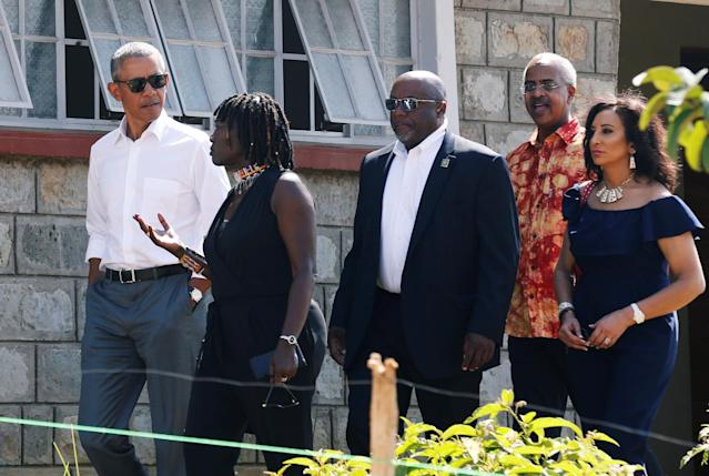 <p>Former U.S. President Barack Obama listens to Auma Obama as he tours the Sauti Kuu resource centre near his ancestral home in Nyangoma Kogelo village in Siaya county, western Kenya July 16, 2018. (Photo: Thomas Mukoya/Reuters) </p>