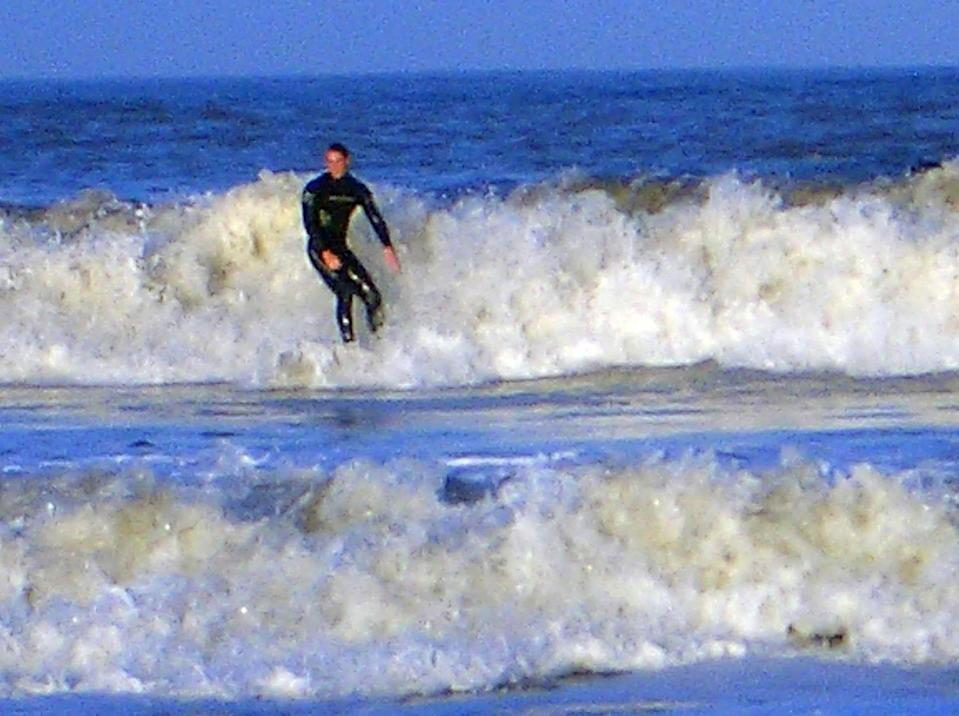 <p>Prince William surfing at St Andrews in Scotland in 2004, during the last year of his university course. (PA Images)</p>