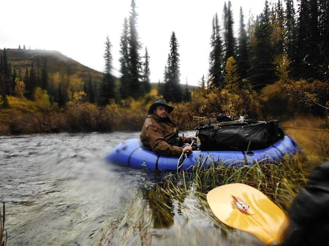 Tordrillo Mountains, Alaska, USA: Austin Manelick on a pack kayak during the trek.