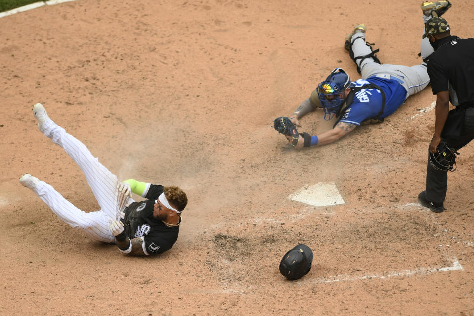 Chicago White Sox's Yoan Moncada (10) gets tagged out at home plate by Kansas City Royals catcher Cam Gallagher during the ninth inning of a baseball game Sunday, May 16, 2021, in Chicago. (AP Photo/Paul Beaty)