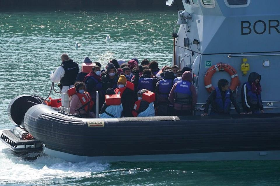 A group of people thought to be migrants are brought in to Dover, Kent, by Border Force officers (Jonathan Brady/PA) (PA Wire)