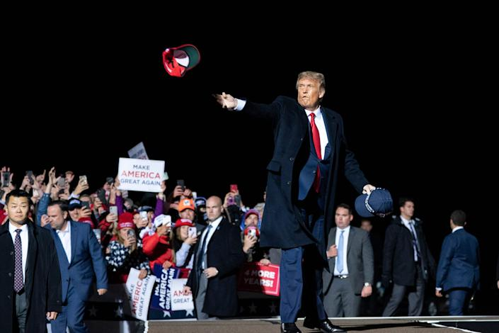 President Donald Trump tosses a hat to supporters as he arrives to speak at a campaign rally at Duluth International Airport, Wednesday, Sept. 30, 2020, in Duluth, Minn. (AP Photo/Alex Brandon) ORG XMIT: MNAB113