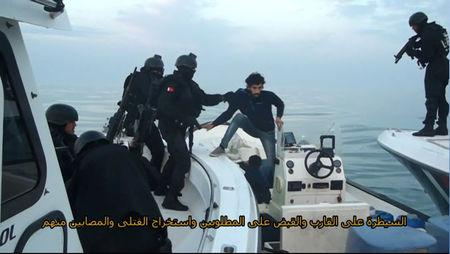 Still image taken from a video provided by Bahraini security officials shows Bahraini forces raiding a speedboat manned by Shi'ite militant fugitives it says were heading for Iran from Bahrain's northeastern coast